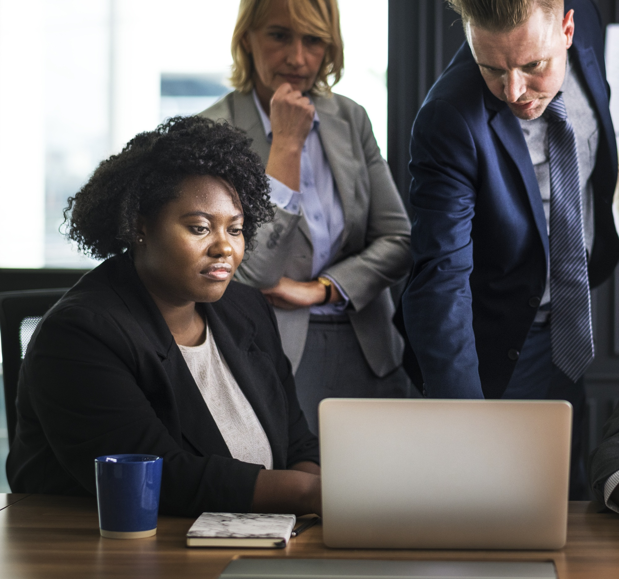 group of business people looking at laptop
