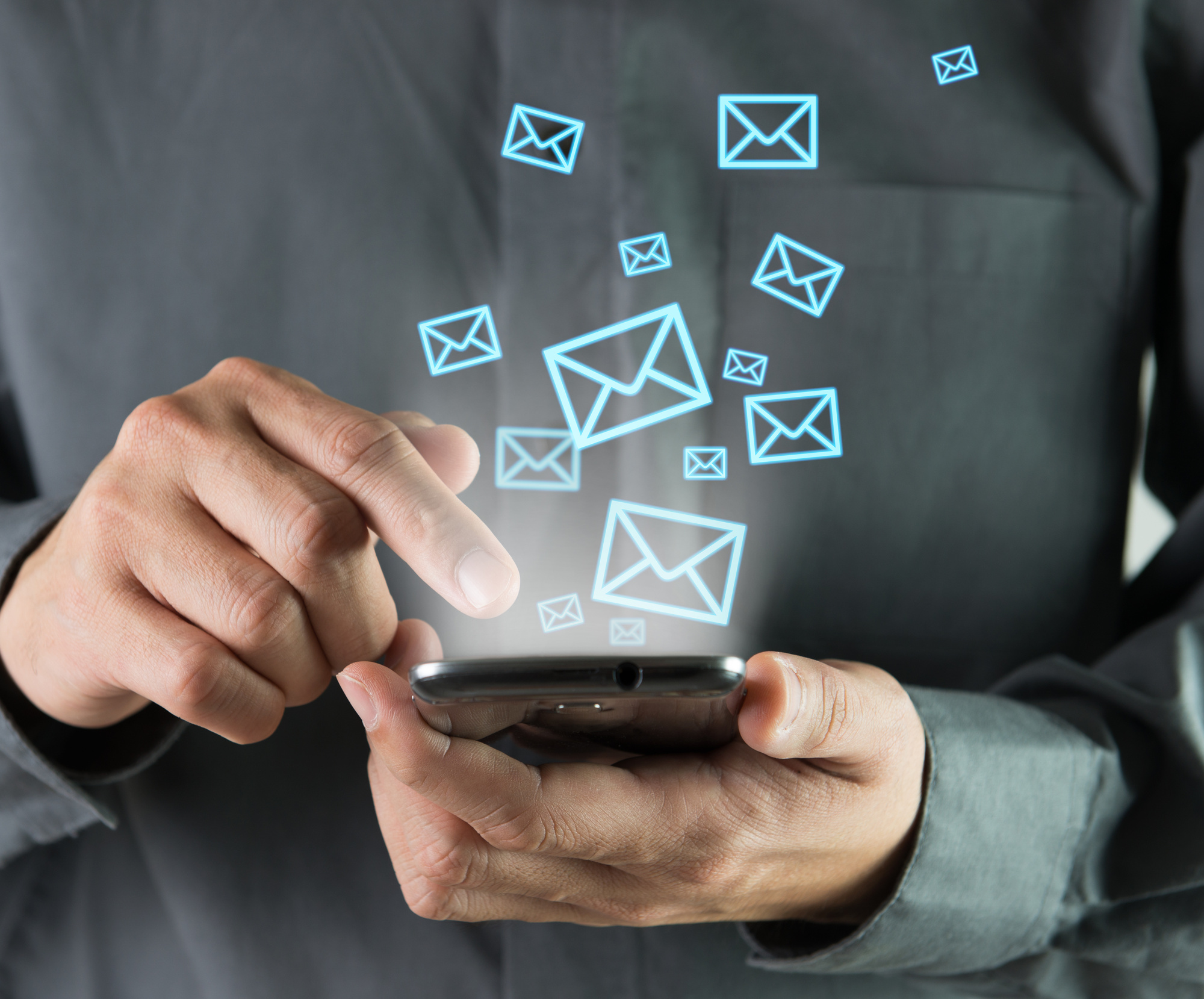 email icons and person with mobile phone