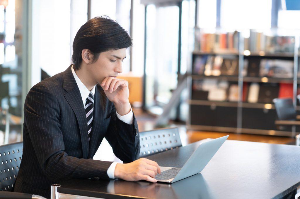 man on web at computer
