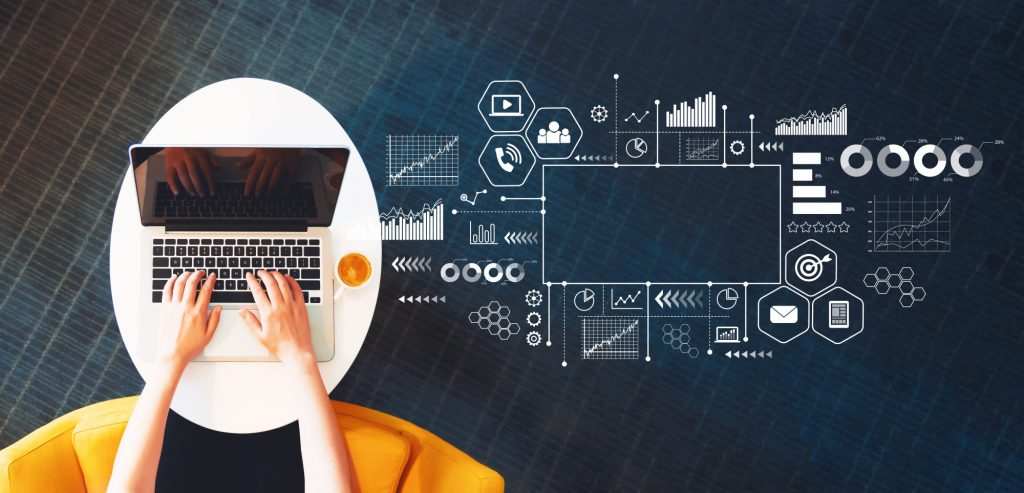digital marketing icons and person with laptop