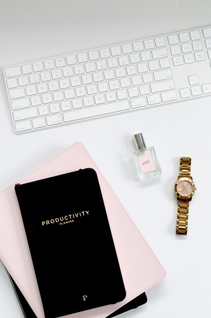 planner keyboard and watch on desk